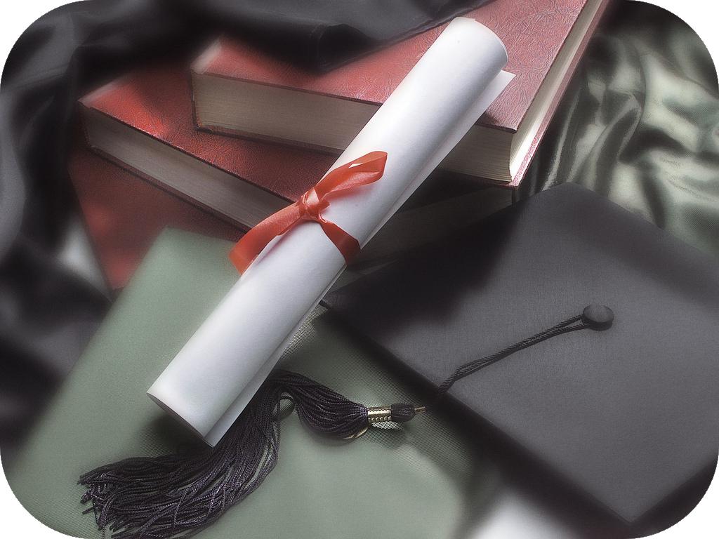 Diploma resting against a graduation cap