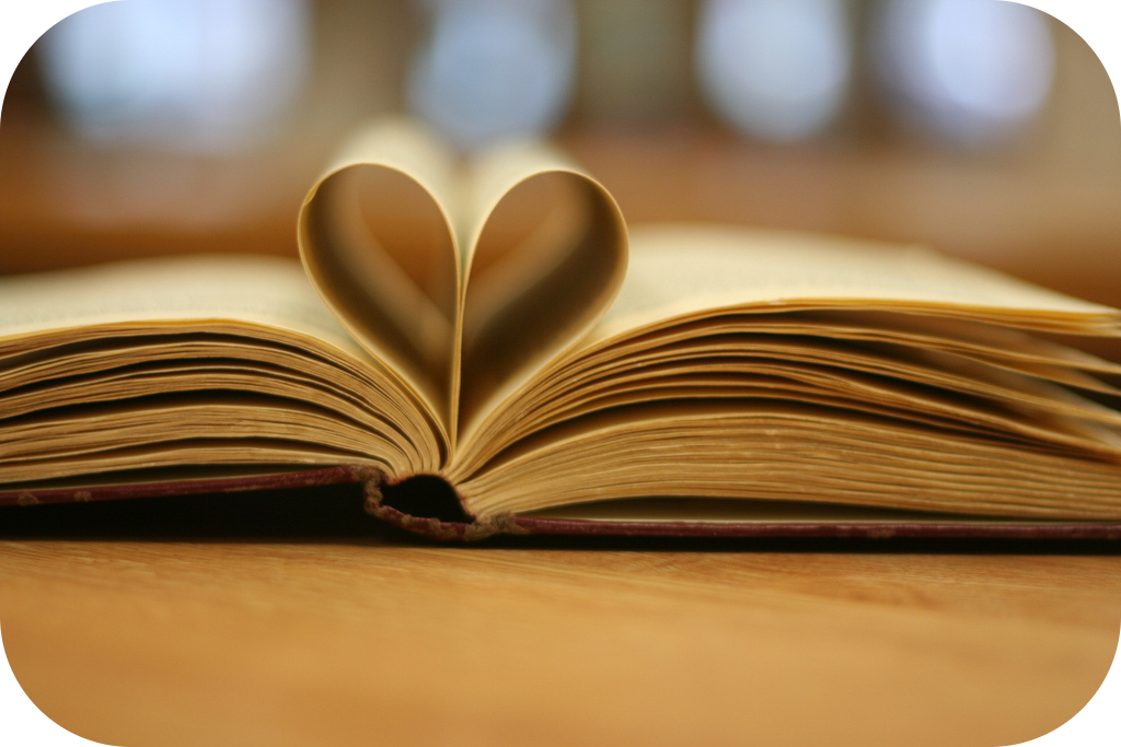 Open book with pages folded in the shape of a heart.
