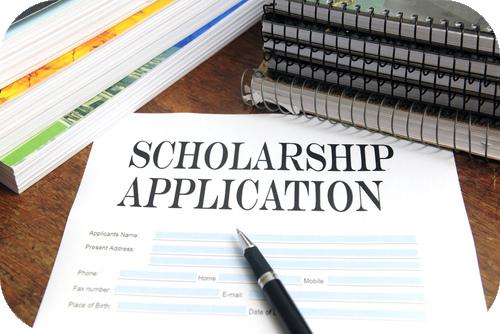 Pen sitting on a scholarship application