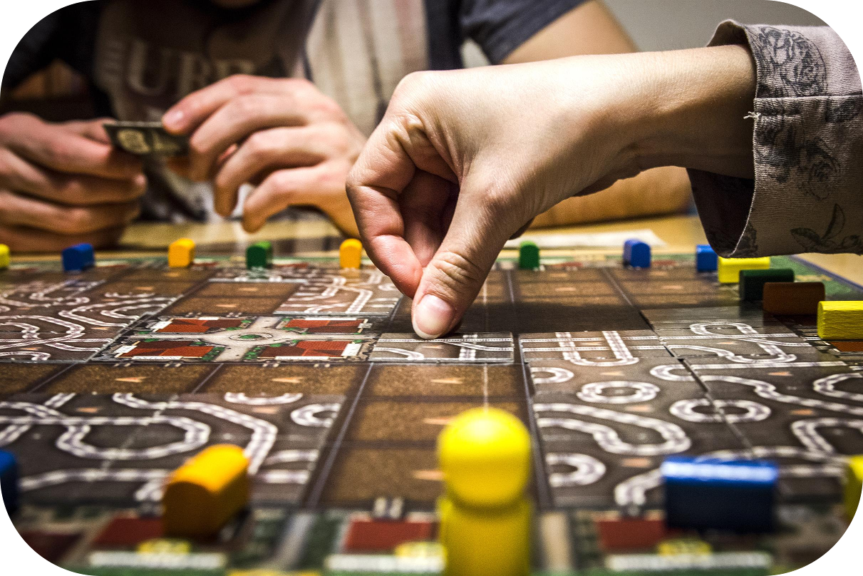 Hands playing a board game
