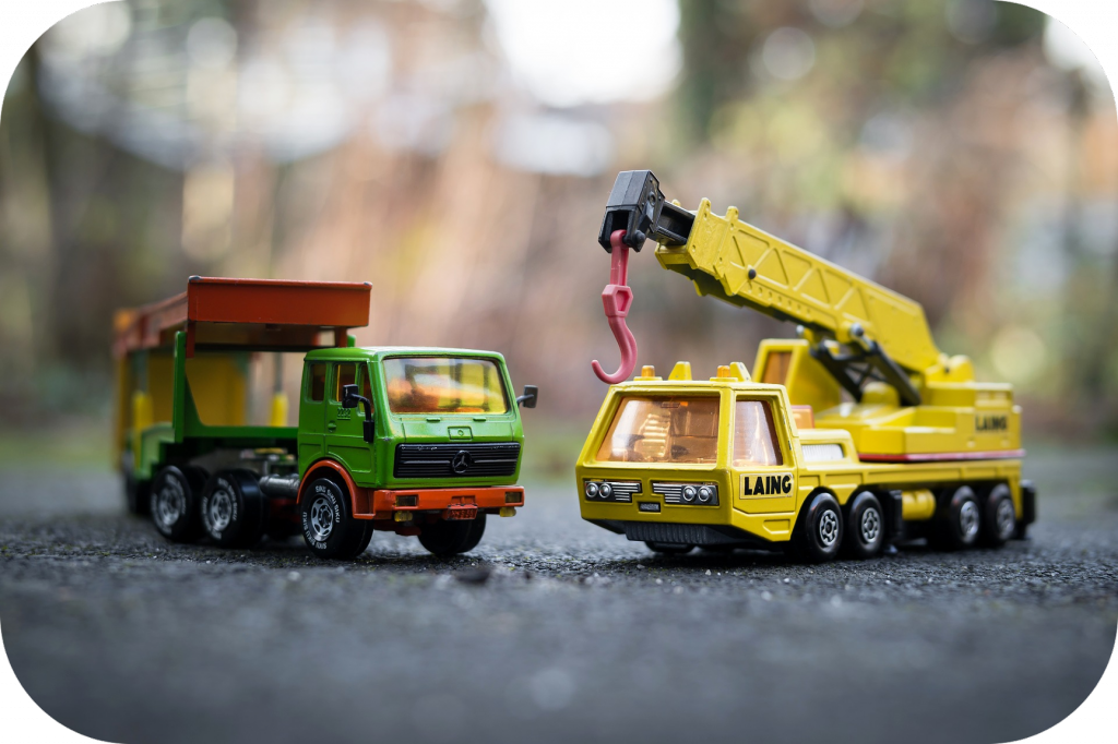 Toy dump truck, toy construction crane