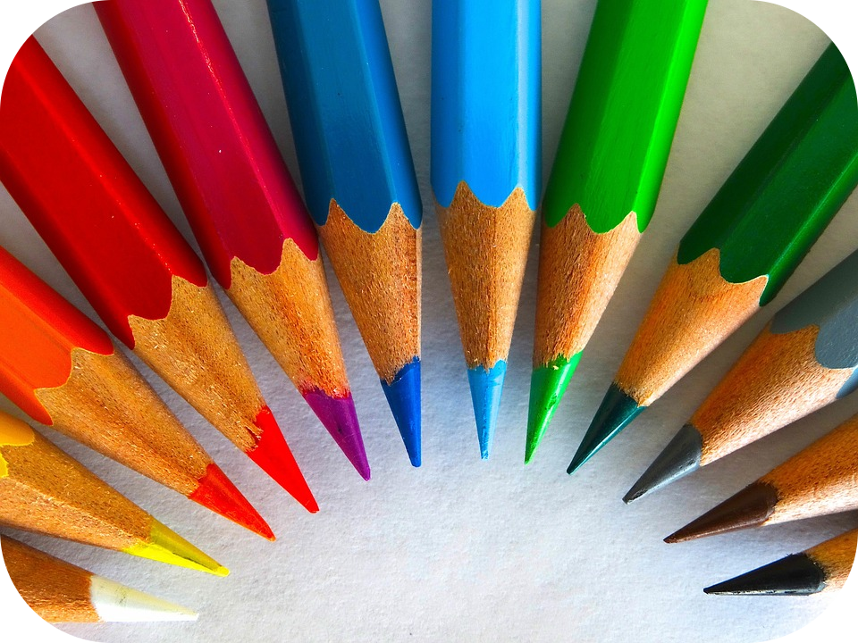 Colored pencils arranged in a semicircle.