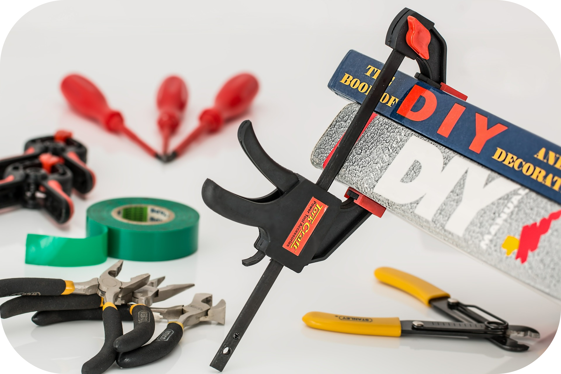 Screwdrivers, clamps, tape, pliers, wire cutters, books