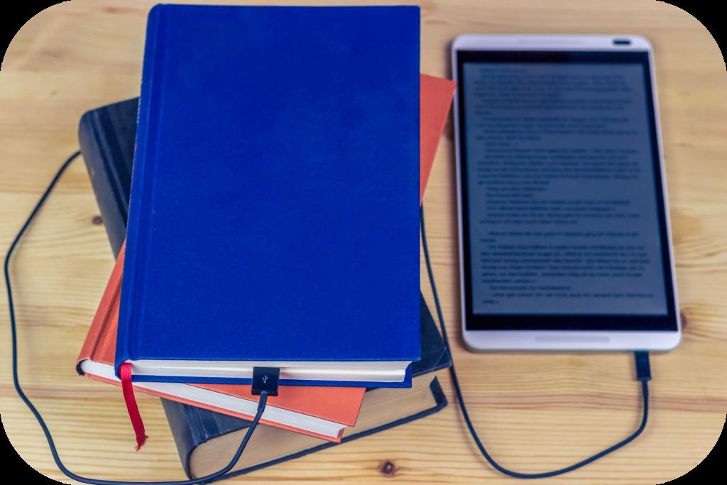 Stack of books, ebook reader