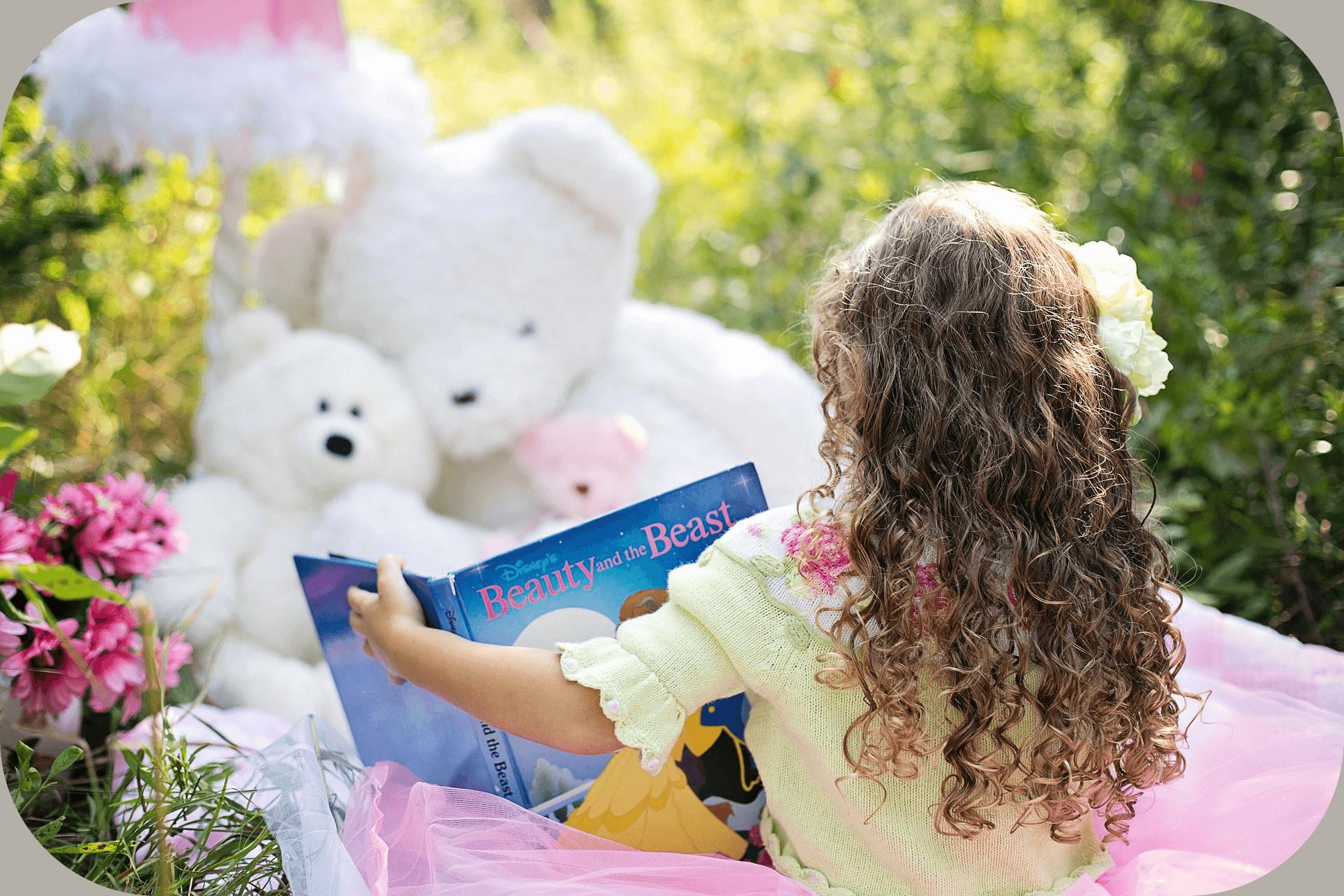 Little girl, teddy bears, book, outdoors