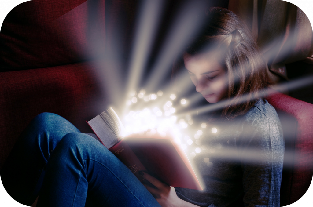 Girl reading a glowing book