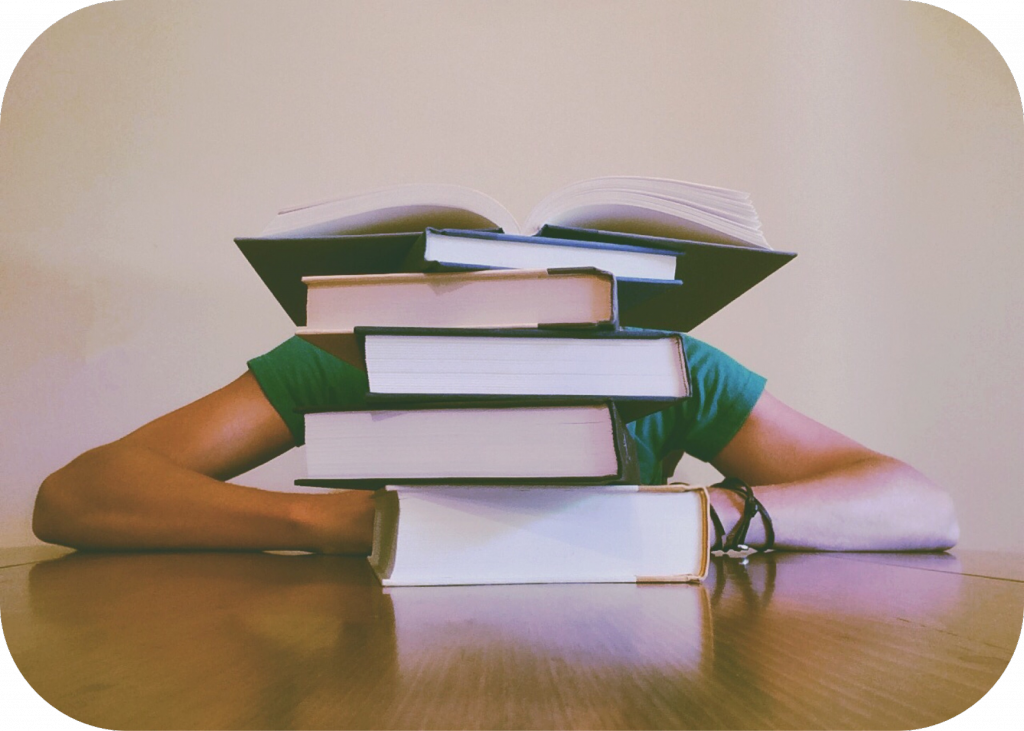 Stack of books, arms, braclet