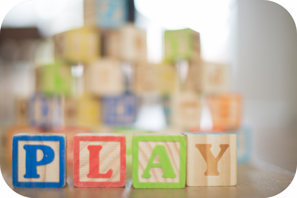 Wooden blocks spelling out the word play