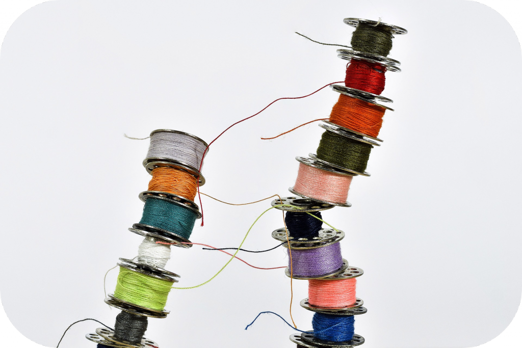Stacked, multicolored thread bobbins