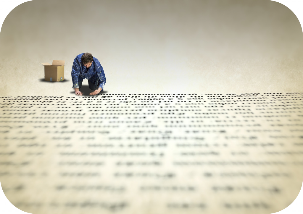 Man on hands and knees writing out oversized text